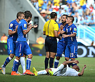 Claudio Marchisio (2nd left) of Italy is shown a red card for a high, studs up challenge on Uruguay's Egidio Arevalo during the 2014 FIFA World Cup match at Arena das Dunas, Natal<br /> Picture by Stefano Gnech/Focus Images Ltd +39 333 1641678<br /> 24/06/2014