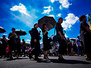 27 SEPTEMBER 2017 - BANGKOK, THAILAND: People walk to the Grand Palace to pay respects to the late king.  The Royal Household has announced that the palace will close to the public, including tourists, on 04 October 2017 to allow officials to complete preparations for the cremation of Bhumibol Adulyadej, the King of Thailand, who died on 13 October 2016. They also extended the official mourning period by 15 days. It was originally set to end on 13 October 2017 but now will end on 26 October 2017, the day of the King's cremation.    PHOTO BY JACK KURTZ