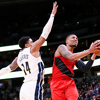 09 April 2018: Portland Trail Blazers guard Damian Lillard (0) goes for the layup past Denver Nuggets guard Gary Harris (14) during the Denver Nuggets 88-82 victory over the Portland Trail Blazers, at the Pepsi Center, Denver, Colorado, USA.