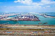 Nederland, Zuid-Holland, Rotterdam, 10-06-2015; Eerste Maasvlakte met Hartelhaven en Mississippihaven (rechts). In het midden Europees Massagoed Overslagbedrijf (EMO), gespecialiseerd in de overslag van kolen en ijzererts. Emplacement Maasvlakte in de voorgrond.<br /> European bulk transshipment (EMO), specializing in the handling of coal and iron ore.<br /> <br /> luchtfoto (toeslag op standard tarieven);<br /> aerial photo (additional fee required);<br /> copyright foto/photo Siebe Swart