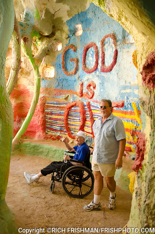 Photograph of Leonard Knight inside Salvation Mountain, returning for the first time in 4 months to his longtime home for a brief visit after being moved to a convalescence center. He had to move to an assisted-care facility in San Diego County in December 2011 because of health problems..Salvation Mountain, Slab City, Niland, California, USA, North America.©Rich Frishman.