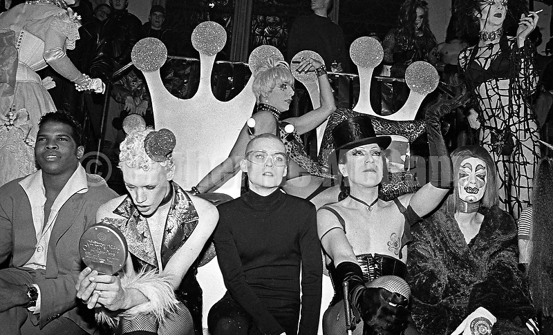 Winter 1994:  Seated, L-R:  unidentified, Kenny Kenny (with mirror), Billy Beyond, Joey Arias (top hat) and unidentified at the Club Kid King and Queen of Manhattan contest at Limelight nightclub in New York City, WInter, 1994