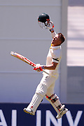 David Warner celebrates scoring a century during the Magellan fourth test match between Australia v England at  the Melbourne Cricket Ground, Melbourne, Australia on 26 December 2017. Photo by Mark  Witte.
