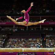Gabrielle Douglas of the United States soared over the balance beam apparatus during her gold medal performance in the women's gymnastics individual all-around finals at North Greenwich Arena during the 2012 Summer Olympic Games in London, England, Thursday, August 2, 2012. (David Eulitt/Kansas City Star/MCT)