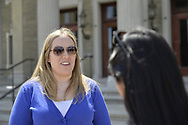 After CAWS water rate rally, Sue M is interviewed, and then she and her family visit the grounds of the Nassau County Executive Building, Theodore Roosevelt Executive building