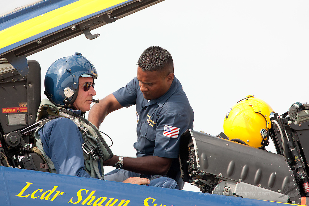 Harrison Ford gets strapped in to Blue Angel #7 by U.S. Marine Corps Staff Sgt. Deo Harrypersaud for a brief demonstation flight flown by Lt. Kevin 'Kojak' Davis at Airventure 2008 in Oshkosh, Wisconsin.