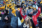 Pittsburgh Steelers fans wave their terrible towels and get fired up during the NFL 2018 AFC Divisional playoff football game against the Jacksonville Jaguars, Sunday, Jan. 14, 2018 in Pittsburgh. The Jaguars won the game 45-42. (©Paul Anthony Spinelli)