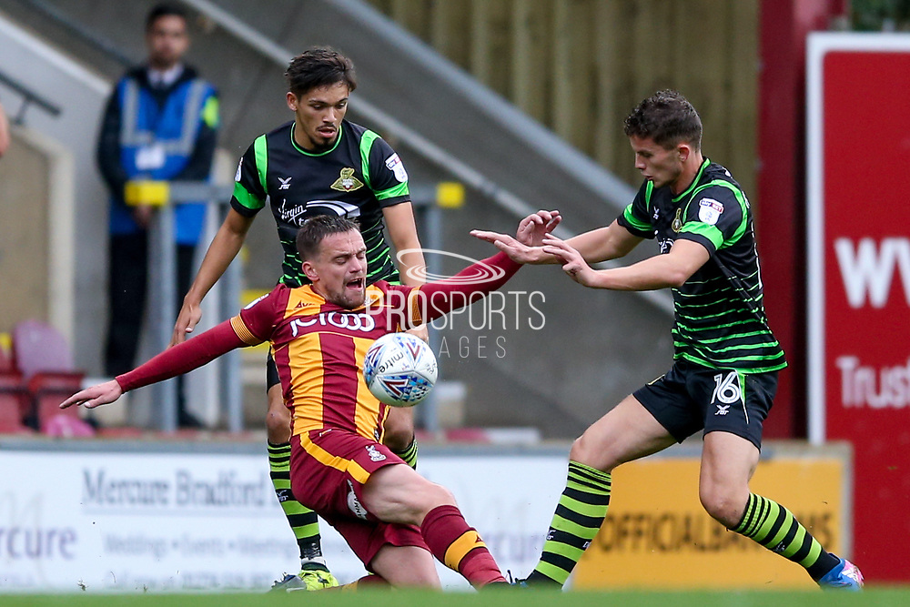 Bradford City forward Paul Taylor (10) is challenged by Doncaster Rovers midfielder Jordan Houghton (16), on loan from Chelsea,  during the EFL Sky Bet League 1 match between Bradford City and Doncaster Rovers at the Northern Commercials Stadium, Bradford, England on 30 September 2017. Photo by Simon Davies.