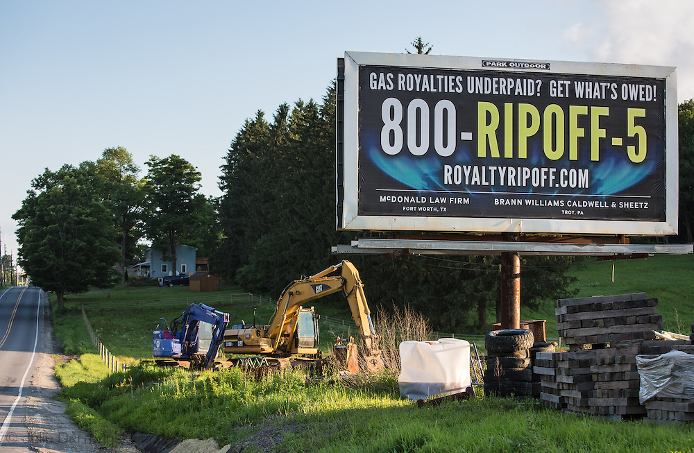Billboard for lawyers representing people ripped off by fracking companies   in Susquehanna County, PA.