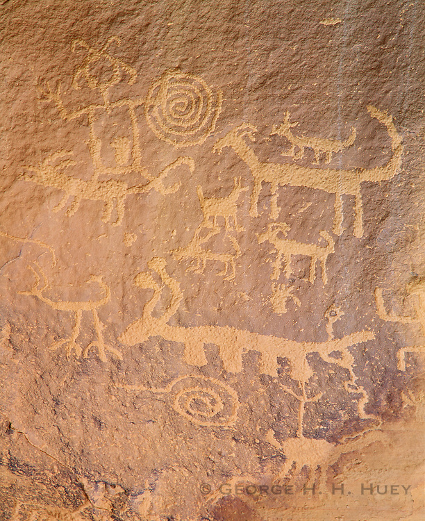 0204-1053 ~ Copyright: George H. H. Huey ~ Anasazi culture petroglyphs above the ruins of Una Vida. Chaco Culture National Historical Park, New Mexico.