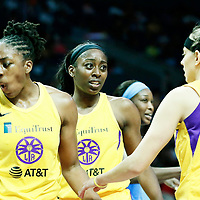 LOS ANGELES, CA - JUN 30: Nneka Ogwumike (30) of the Los Angeles Sparks is seen next to Chiney Ogwumike (13) of the Los Angeles Sparks and Sydney Wiese (24) of the Los Angeles Sparks during a game on June 30, 2019 at the Staples Center, in Los Angeles, California.