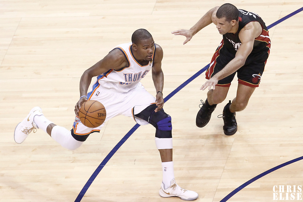 14 June 2012: Oklahoma City Thunder small forward Kevin Durant (35) drives past Miami Heat small forward Shane Battier (31) during the Miami Heat 100-96 victory over the Oklahoma City Thunder, in Game 2 of the 2012 NBA Finals, at the Chesapeake Energy Arena, Oklahoma City, Oklahoma, USA.
