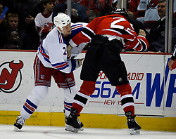 Feb 20, 2007; East Rutherford, NJ, USA; New York Rangers forward Colton Orr (28) and New Jersey Devils forward Cam Janssen (25) fight during the third period at Continental Airlines Arena in East Rutherford, NJ.