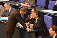 25 SEP 2003, BERLIN/GERMANY:<br /> Gerhard Schroeder (L), SPD, Bundeskanzler, und Guido Westerwelle (R), FDP Bundesvorsitzender, im Gespraech, waehrend  der Bundestagsdebatte zur aktuellen Lage im Irak, Plenum, Deutscher Bundestag<br /> IMAGE: 20030925-01-080<br /> KEYWORDS: Gerhard Schröder, im Gespräch