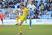 Coventry City striker Stuart Beavon (16) challenges Bristol Rovers midfielder Chris Lines (14) 0-0 during the EFL Sky Bet League 1 match between Coventry City and Bristol Rovers at the Ricoh Arena, Coventry, England on 25 March 2017. Photo by Alan Franklin.