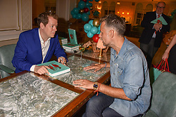 Tom Parker Bowles and Richard Bacon at the launch of the Fortnum & Mason Christmas & Other Winter Feasts Cook Book by Tom Parker Bowles held at Fortnum & Mason, 181 Piccadilly, London, England. 17 October 2018.