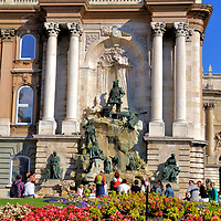 Matthias Fountain at Buda Castle in Budapest, Hungary <br /> The Matthias Fountain at Buda Castle protrays a large stag at the feet of the 15th century king. At the base of the waterfall are hunters with their dogs. Depicted in the right corner is Ilonka, a poor girl King Matthias met and fell in love with during this hunting trip. The Mátyás Kúitja was designed by Alajos Stróbl and erected in the northern courtyard in 1904.
