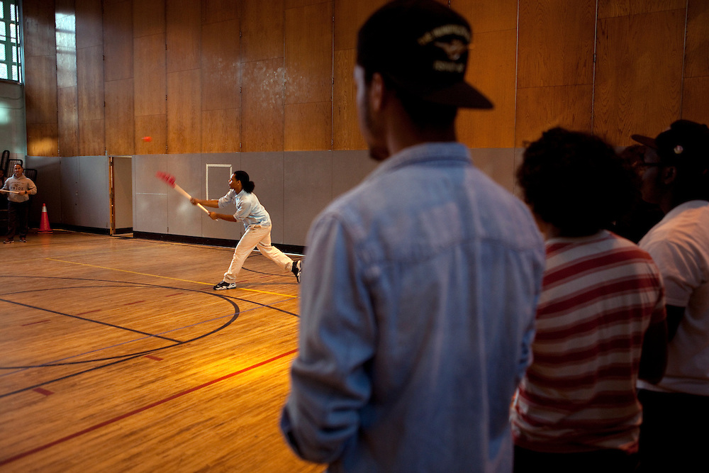 Peer leader Brander Suero, 16, center, playing Lacrosse during physical education class in the gym at Central Park East High School in New York, NY on November 15, 2012. Beyond sheer physical safety, a look at how schools and districts can create classroom conditions in which students are able to engage enthusiastically and without emotional fear of stepping forward. Photographer: Melanie Burford/Prime