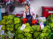 08 JUNE 2017 - BANGKOK, THAILAND: A banana vendor in Khlong Toey Market, Bangkok's main fresh market. Thai consumer confidence dropped for the first time in six months in May following a pair of bombings in Bangkok, low commodity prices paid to farmers and a sharp rise in the value of the Thai Baht versus the US Dollar and the EU Euro. The Baht is surging because of political uncertainty, related to Donald Trump, in the US and Europe. The Baht's rise is being blamed for a drop in Thai exports. This week the Baht has been trading at around 33.90 Baht to $1US, it's highest point in two years.      PHOTO BY JACK KURTZ