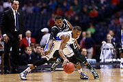 INDIANAPOLIS, IN - MARCH 29: Rasheed Sulaimon #14 of the Duke Blue Devils tries to keep the ball away from Keith Appling #11 of the Michigan State Spartans during the regional round of the 2013 NCAA Men's Basketball Tournament at Lucas Oil Stadium on March 29, 2013 in Indianapolis, Indiana. (Photo by Joe Robbins)