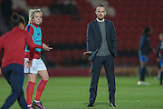 Mark Sampson (Manager) (England) watches his players warming up before the International Friendly match between England Women and France Women at the Keepmoat Stadium, Doncaster, England on 21 October 2016. Photo by Mark P Doherty.