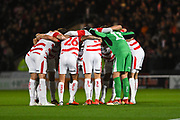 Doncaster players huddle before the EFL Sky Bet League 1 match between Doncaster Rovers and Sunderland at the Keepmoat Stadium, Doncaster, England on 23 October 2018.