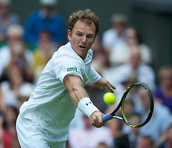 LONDON, ENGLAND - Monday, June 20, 2011: Michael Russell (USA) in action during the Gentlemen's Singles 1st Round match on during day one of the Wimbledon Lawn Tennis Championships at the All England Lawn Tennis and Croquet Club. (Pic by David Rawcliffe/Propaganda)