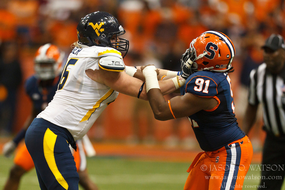 Oct 21, 2011; Syracuse NY, USA;  Syracuse Orange defensive end Brandon Sharpe (91) is blocked by West Virginia Mountaineers offensive linesman Pat Eger (76) during the fourth quarter at the Carrier Dome.  Syracuse defeated West Virginia 49-23. Mandatory Credit: Jason O. Watson-US PRESSWIRE