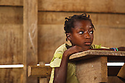 A girl rests her head on her desk during class at the Podio primary school in the village of Podio, Bas-Sassandra region, Cote d'Ivoire on Friday March 2, 2012.