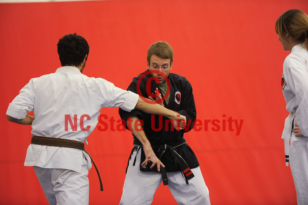 Students participate in a mixed martial arts class at Carmichael Gym. Photo by Marc Hall
