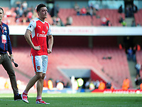 Football - 2016 / 2017 Premier League - Arsenal vs. Everton<br /> <br /> A dejected Mesut Ozil of Arsenal after failing to qualify for the Champions League on the walk around the stadium after the match at The Emirates.<br /> <br /> COLORSPORT/ANDREW COWIE