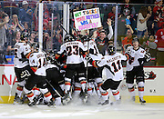 The Calgary Hitmen flood onto the ice after a double overtime victory versus the Medicine Hat Tigers in game 5 of their series in Calgary on Monday, May 12, 2014. (Photo by Jenn Pierce)