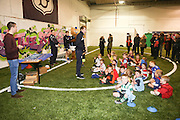 Dundee Fc player Cammy Kerr (left) presented the prizes at Dundee FC in the Community Champions League Finals night  - Dundee FC in the Community kids Champions League finals at Manhattan Works<br /> <br />  - &copy; David Young - www.davidyoungphoto.co.uk - email: davidyoungphoto@gmail.com