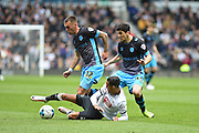 Sheffield Wednesday defender Jack Hunt battles with Derby County midfielder Tom Ince during the Sky Bet Championship match between Derby County and Sheffield Wednesday at the iPro Stadium, Derby, England on 23 April 2016. Photo by Jon Hobley.