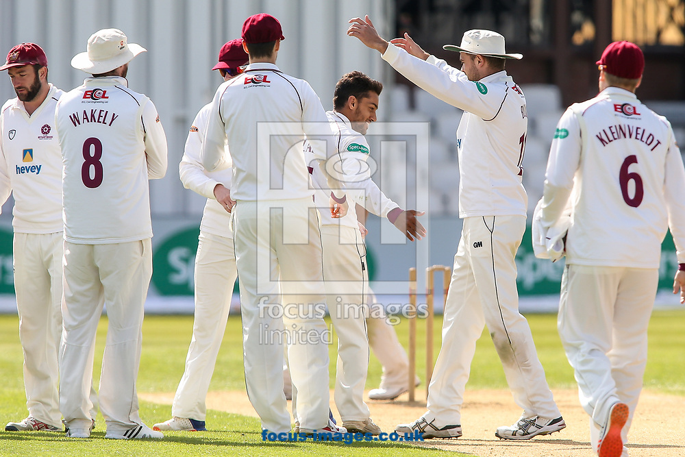 Northants CCC players celebrate a wicket taken by Saif Zaib of Northamptonshire CCC (centre) during day two of the Friendly match at the County Ground, Northampton<br /> Picture by Andy Kearns/Focus Images Ltd 0781 864 4264<br /> 03/04/2017