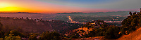 Panoramic view of the San Fernando Valley with the San Gabriel Mountains behind, with Van Nuys Boulevard in the middle, shot above Sherman Oaks from Mulholland Drive at twilight, Los Angeles, California USA.