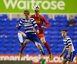 READING, ENGLAND - Wednesday, March 12, 2014: Liverpool's Lloyd Jones in action against Reading's Sammi Fridjonsson during the FA Youth Cup Quarter-Final match at the Madejski Stadium. (Pic by David Rawcliffe/Propaganda)