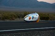 Sebastiaan Bowier in de VeloX2 tijdens de zesde racedag van de WHPSC. In de buurt van Battle Mountain, Nevada, strijden van 10 tot en met 15 september 2012 verschillende teams om het wereldrecord fietsen tijdens de World Human Powered Speed Challenge. Het huidige record is 133 km/h.<br /> <br /> Sebastiaan Bowier in the VeloX2 on the sixth day of the WHPSC. Near Battle Mountain, Nevada, several teams are trying to set a new world record cycling at the World Human Powered Vehicle Speed Challenge from Sept. 10th till Sept. 15th. The current record is 133 km/h.