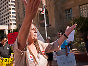 15 OCTOBER 2011 - PHOENIX, AZ:   A MoveOn.org organizer gets the crowd going at a rally sponsored by MoveOn.org and several labor unions to press for job creation in Phoenix, AZ, Saturday. About 100 people attended the rally.   PHOTO BY JACK KURTZ