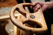 LIUZHOU, CHINA - MAY 19: (CHINA OUT) <br /> <br /> Wooden Three-wheeled Vehicle<br /> <br />  The wooden steering wheel is seen on May 16, 2014 in Liuzhou, Guangxi Province of China. Wei Guirong, 66, has made three wooden three-wheeled vehicles for grandchildren, and the vehicles are made entirely from wood, apart from the engine, wheels and some electronic parts. He was in charge of maintaining agricultural machinery when he was younger. <br /> ©Exclusivepix