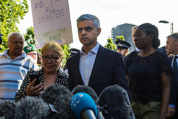 London, June 15th 2017. Mayor of London Sadiq Khan addresses the media and takes questions from the press and members of the crowd near the scene of the Grenfell Tower fire disaster, calling for a interim inquiry findings whilst a fuller, more in depth inquiry is ongoing.