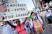 17 AUGUST 2009 -- PHOENIX, AZ: Grace Preston (CQ) from Chandler and Pete Cerchiara (CQ) from Scottsdale demonstrate in favor of health care reform. About 5,000 people were expected to demonstrate in favor of President Obama's health care proposals. Nearly 1,500 showed up to demonstrate against the President.   PHOTO BY JACK KURTZ