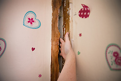 © Licensed to London News Pictures. 11/08/2017. London, UK. A resident shows a large crack in a bedroom wall on the 12th floor of a tower block on the Ledbury Estate. Residents on the Ledbury Estate in south London have been told they will have to leave their properties over the next few weeks. A structural survey carried out after the Grenfell fire found cracks that could lead to a collapse of the building if a gas explosion occured in one of the flats. Photo credit: Peter Macdiarmid/LNP