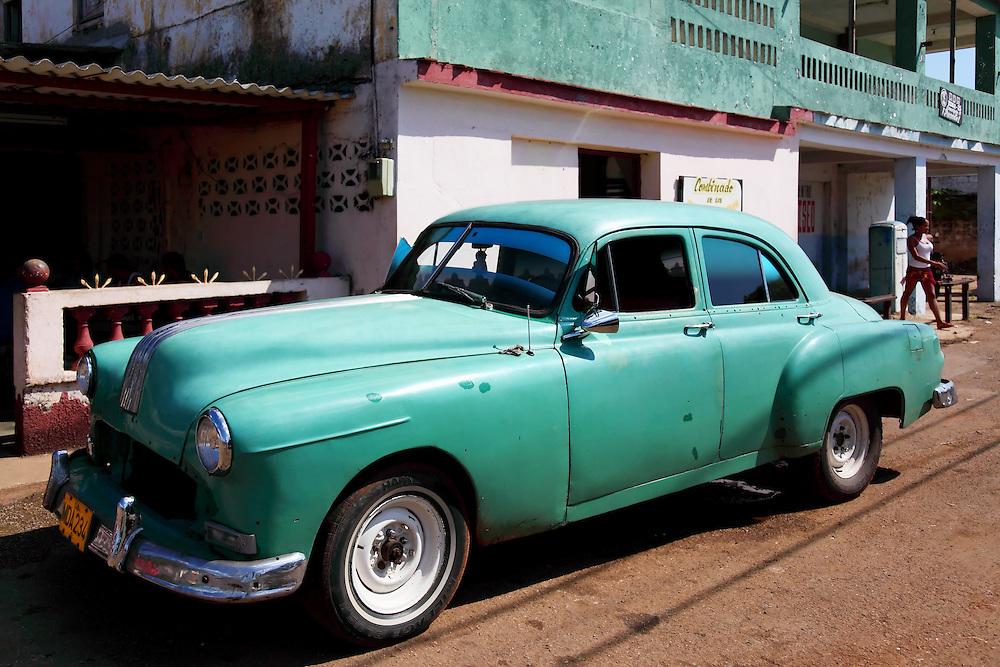 Green car in Coliseo, Matanzas, Cuba.