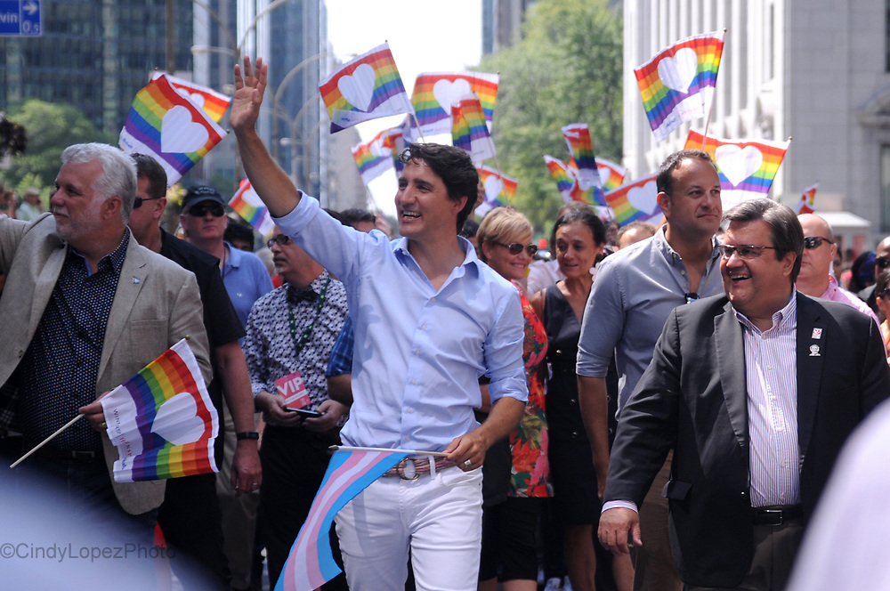 Prime Minister Justin Trudeau along with Irish Taoiseach Leo Varadkar (right) marching in Fierté Montréal Parade with Quebec Premier Philippe Couillard (left) and Montreal Mayor Denis Coderre (front, right). August 20 2017. (Cult MTL)