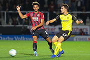 Bournemouth defender Lloyd Kelly challenges Burton Albion forward Oliver Sarkic during the EFL Cup match between Burton Albion and Bournemouth at the Pirelli Stadium, Burton upon Trent, England on 25 September 2019.