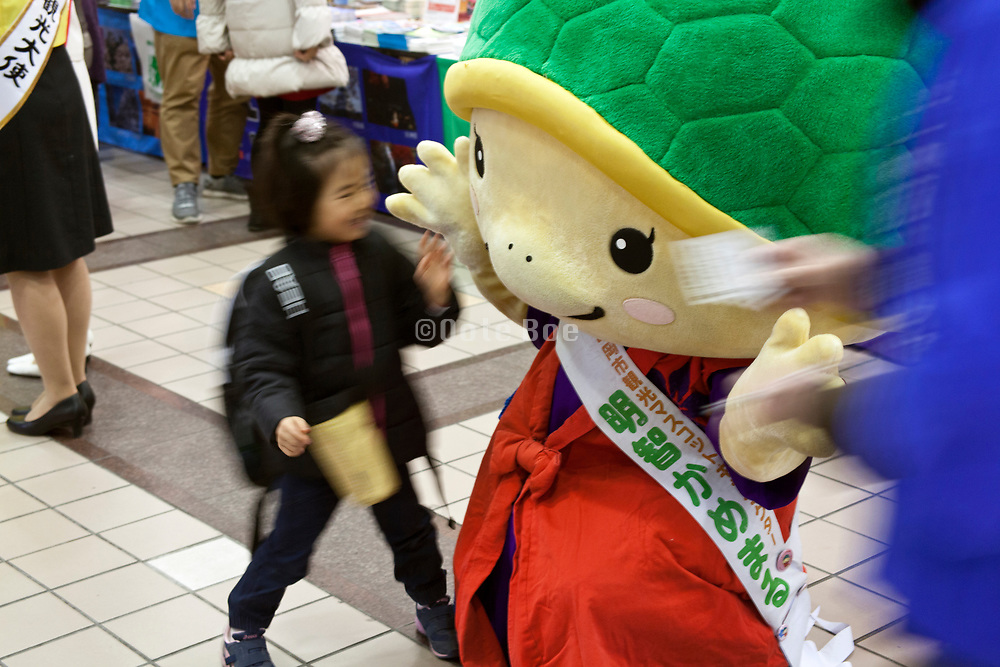Japanese Yuru chara mascot with a happy child