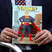 Lima resident Gary Kill (cq) holds a Trump-themed coloring book that he got signed by President Donald J. Trump at Lima Allen County Airport in Lima, Ohio, on Wednesday, March 20, 2019. THE BLADE/KURT STEISS <br /> CTY trump21