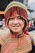 Young Hmong woman wearing beaded headdress at Bac Ha sunday market, Vietnam