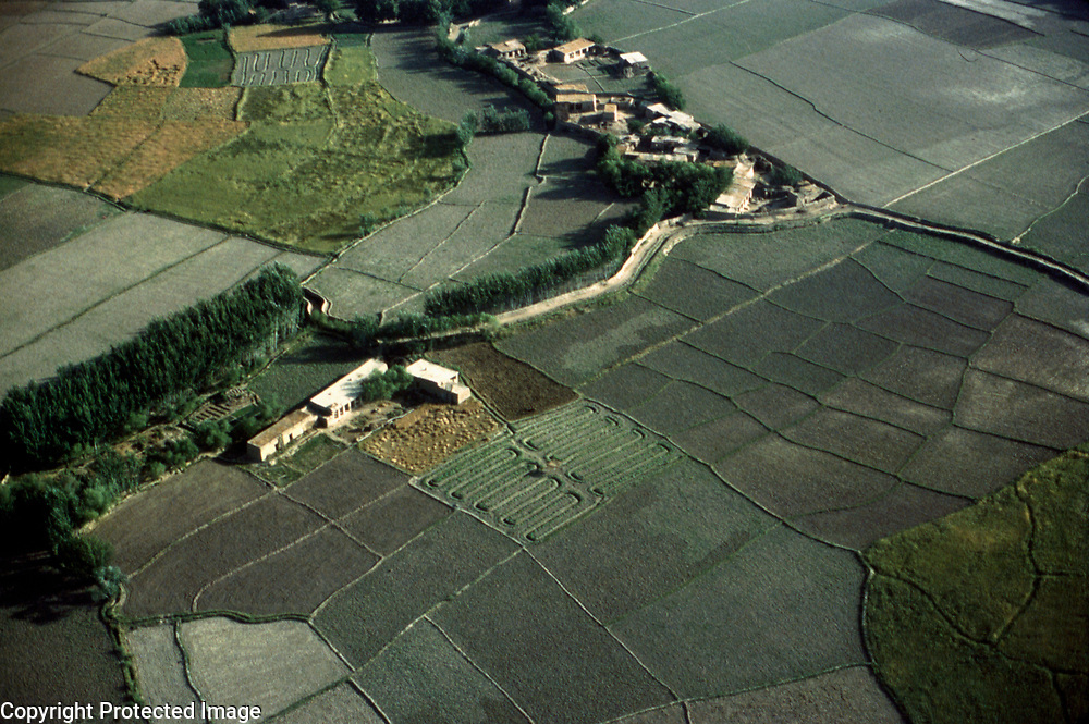 3 June 1976<br /> Households and trees beside river. Melon fields plowed in &quot;S&quot; pattern.